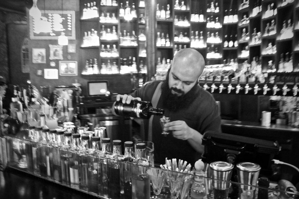 """Antonio Molinero makes his Brockmans cocktail, the """"Frozen Lake"""" at Kill Devil in Williamsburg, Brooklyn"""