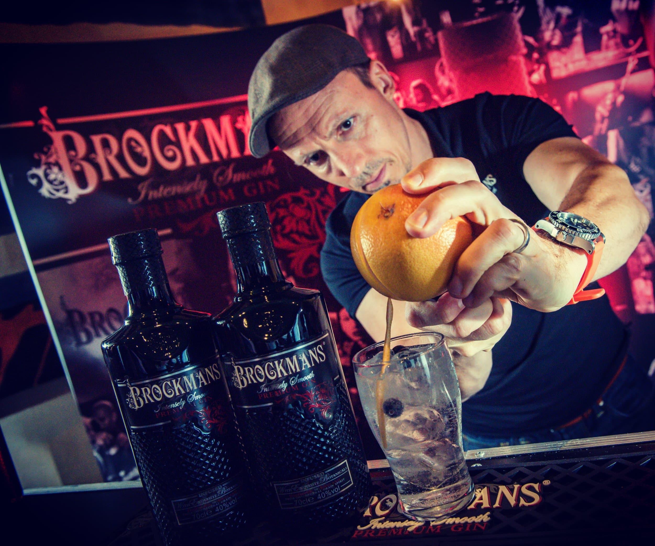 Barman pouring Brockmans cocktail