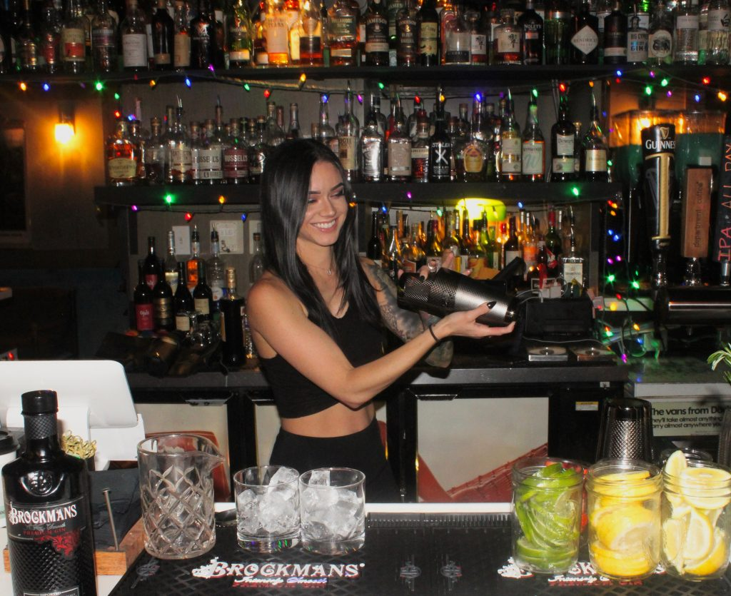 Nikki Diaz makes her Brockmans cocktail, the Black Widow, at Better Days in Miami