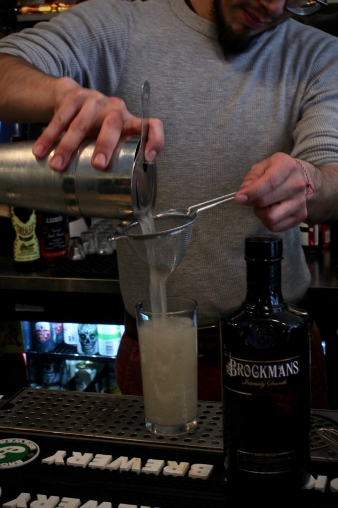 Leo Cazares makes his Brockmans cocktail, Summer Angel, at Erv's on Beekman in Brooklyn, New York.