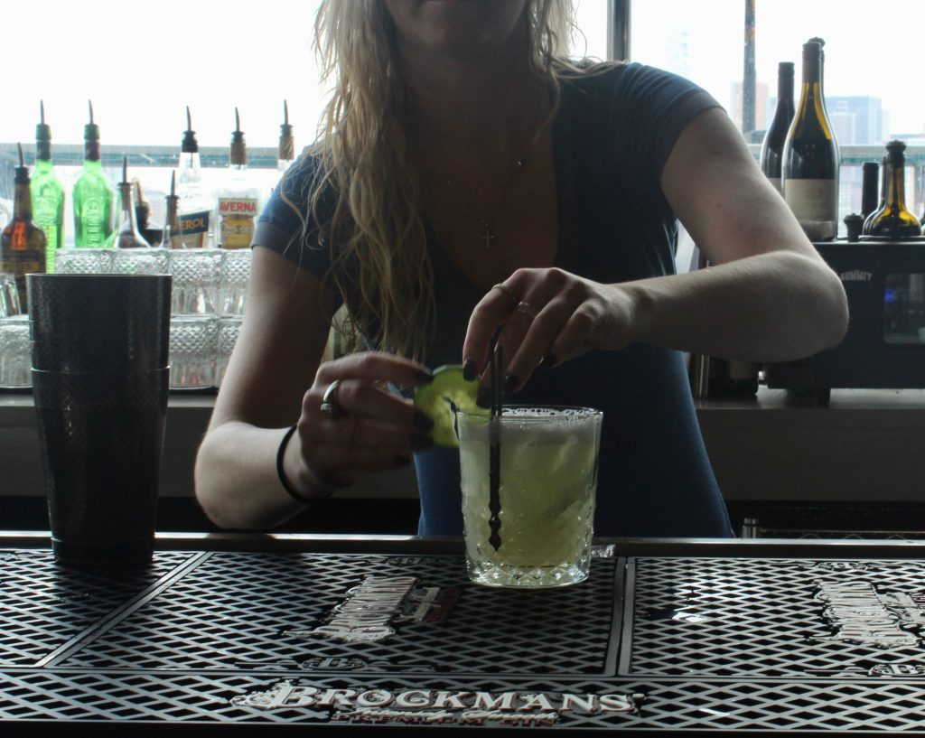 "Jessica Wlazlowski makes the ""Cucumber Bliss"" at Hudson & Co in Jersey City, New Jersey."