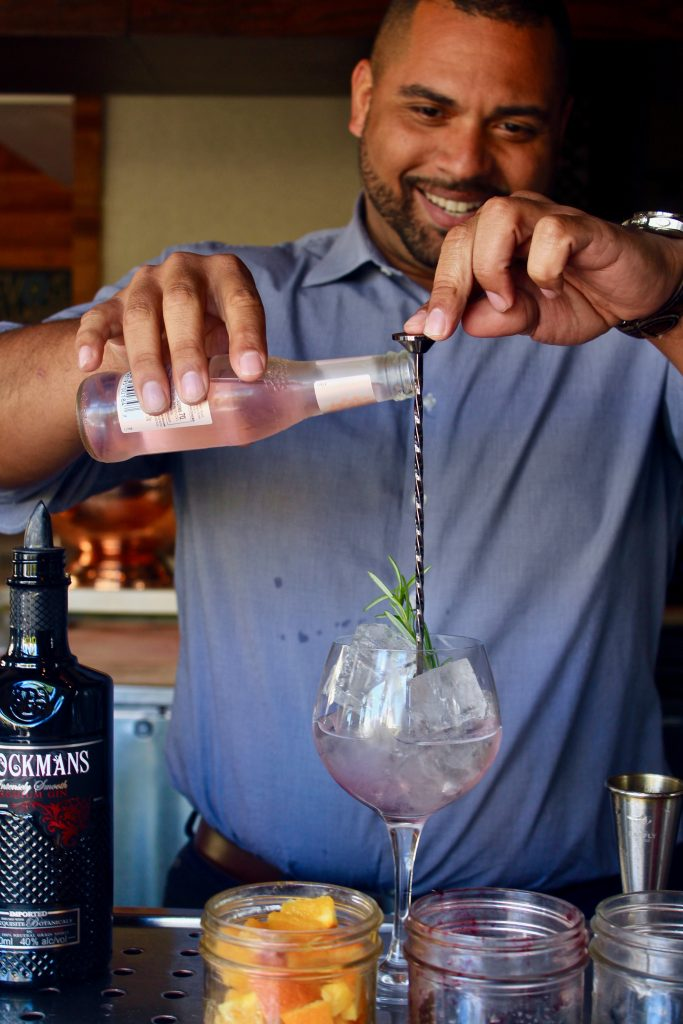 "Joel Mesa makes a ""Stay Classy,"" the Brockmans and tonic at Bulla Gastropub in Miami, Florida."