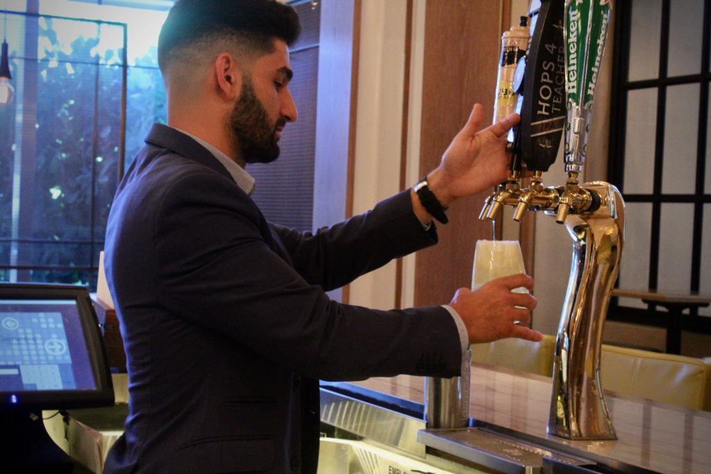 Sean Benna makes his Brockmans cocktail, the Fancy Shandy, at Edge Steak and Bar in the Four Seasons Miami