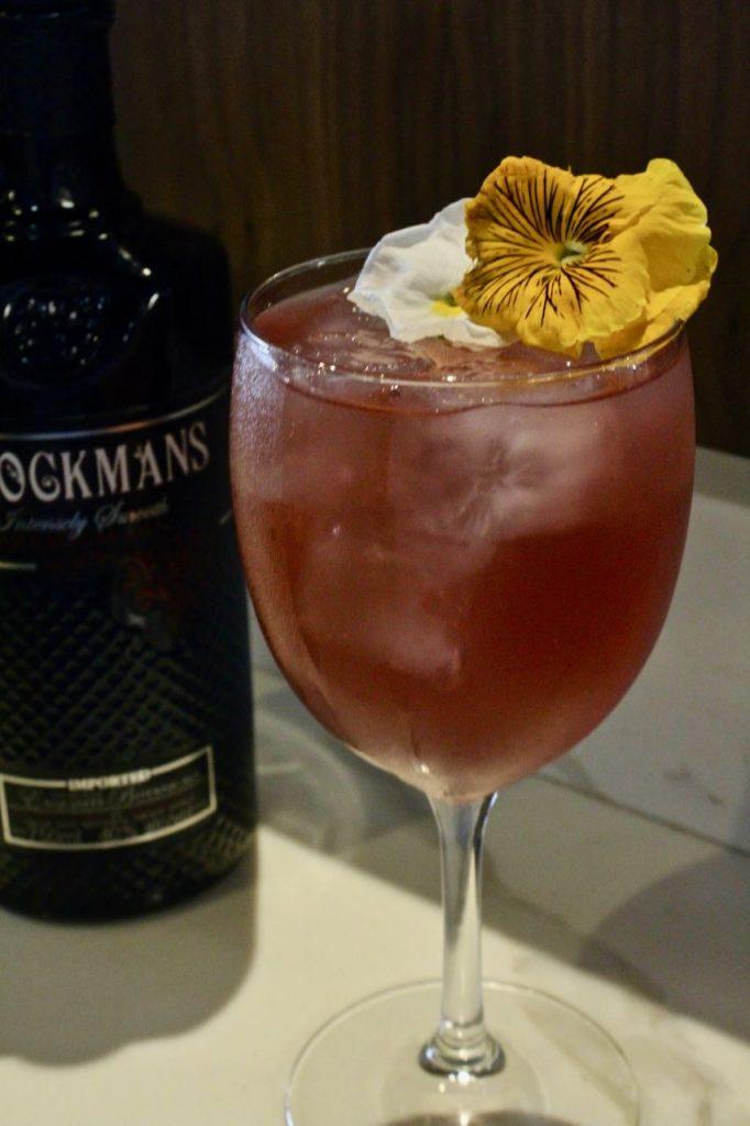 Jennie Kreider makes an original Brockmans cocktail at 1764 Public House in St. Louis, Missouri.