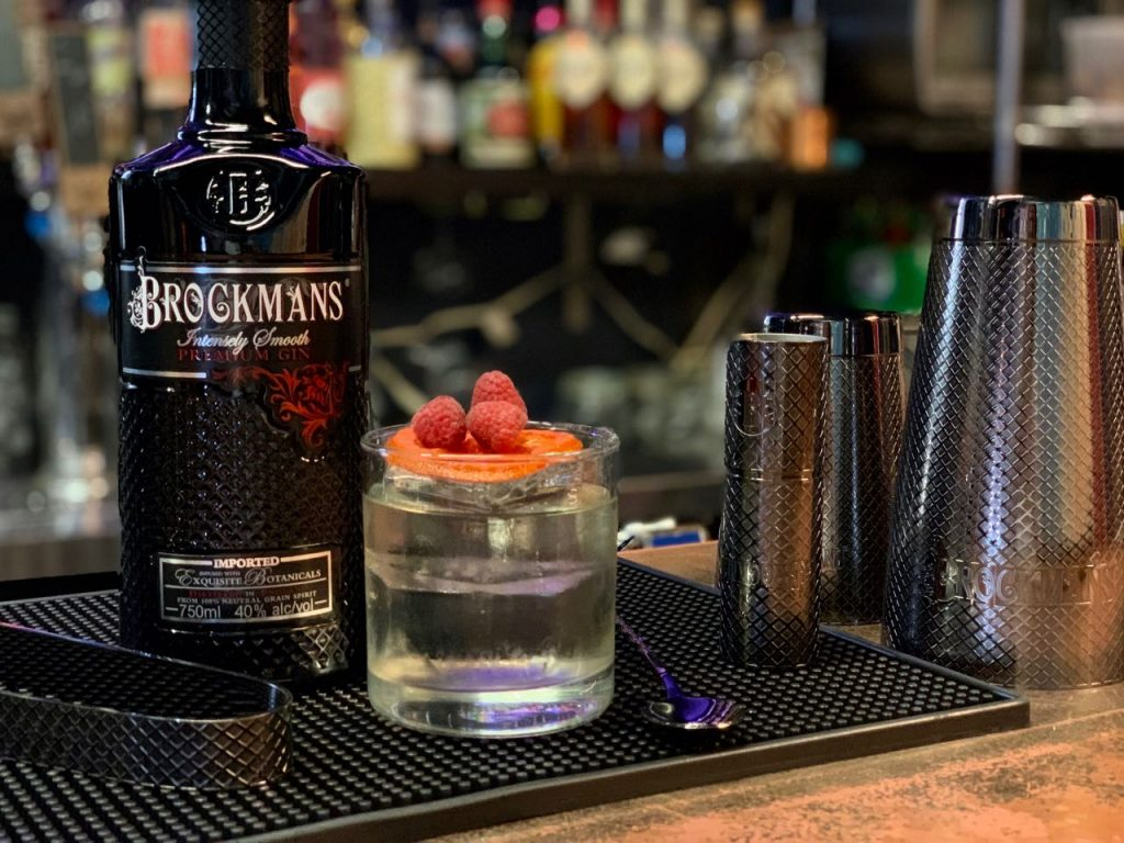 Dimitri Zahariadis makes his Brockmans White Negroni at Highland Brass Co in Waterbury, Connecticut