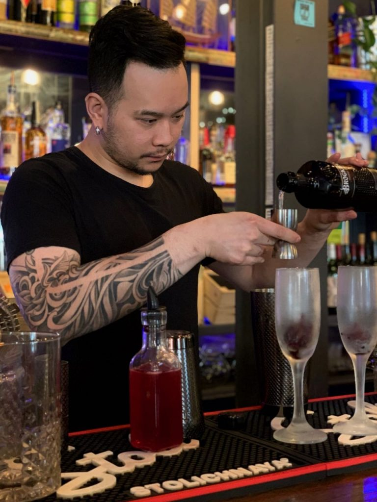 Bobby Chompupang makes his Brockmans cocktail, the Siam Orchid, at Bangkok Bistro in Burlington, Vermont