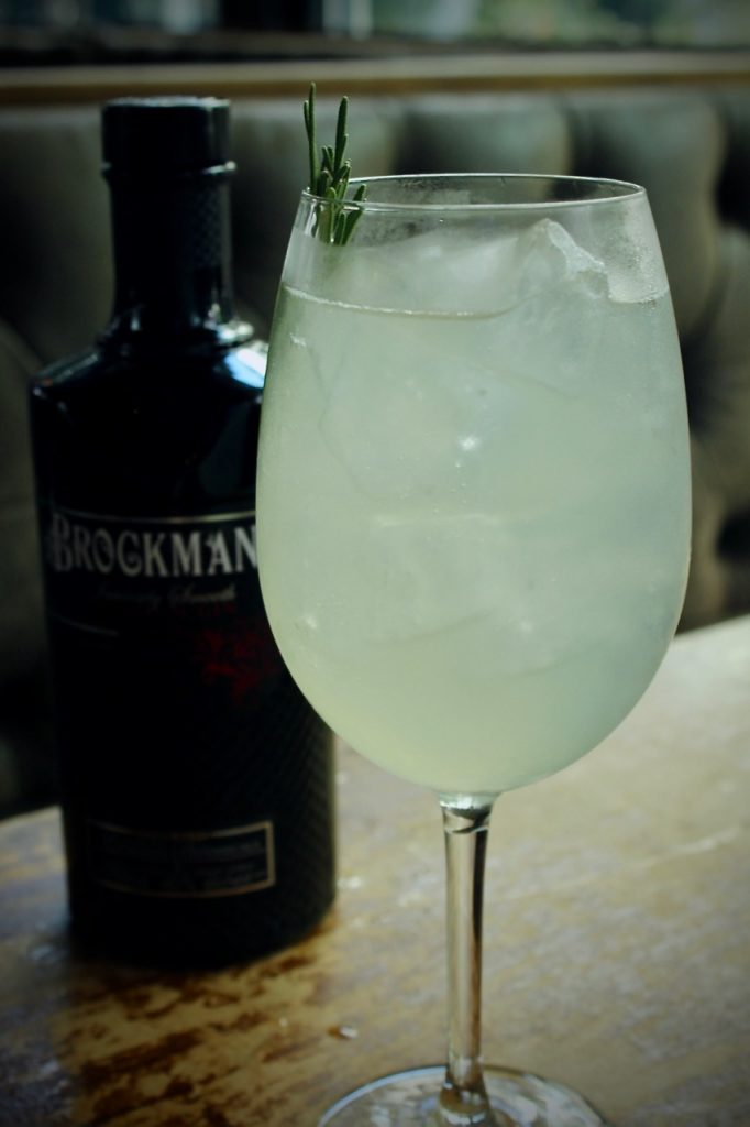 """Michell Boyd makes her Brockmans cocktail, the """"Blueberry Yum Yum"""" at Hampton and Hudson in Atlanta, Georgia."""