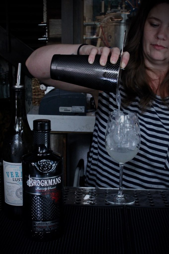 "Michell Boyd makes her Brockmans cocktail, the ""Blueberry Yum Yum"" at Hampton and Hudson in Atlanta, Georgia."