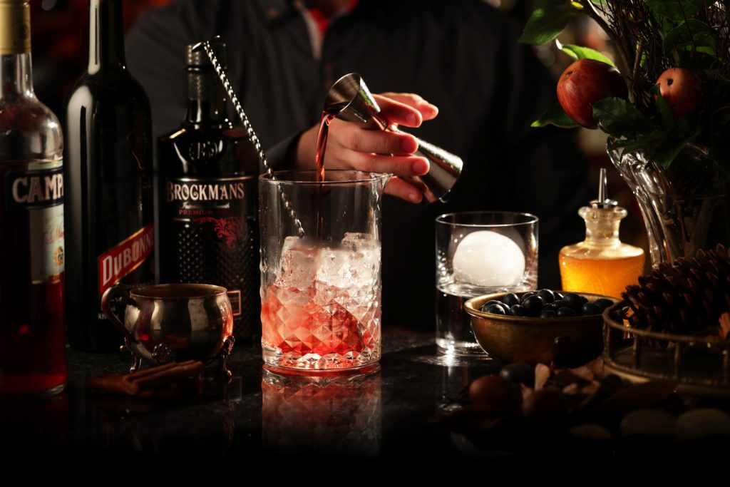 Making a classic Brockmans Gin Negroni