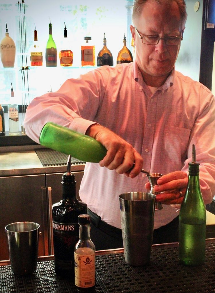 "Rick Blumberg makes his Brockmans cocktail, the ""Rambling Rose"", at Marlow's Tavern in Atlanta, Georgia."