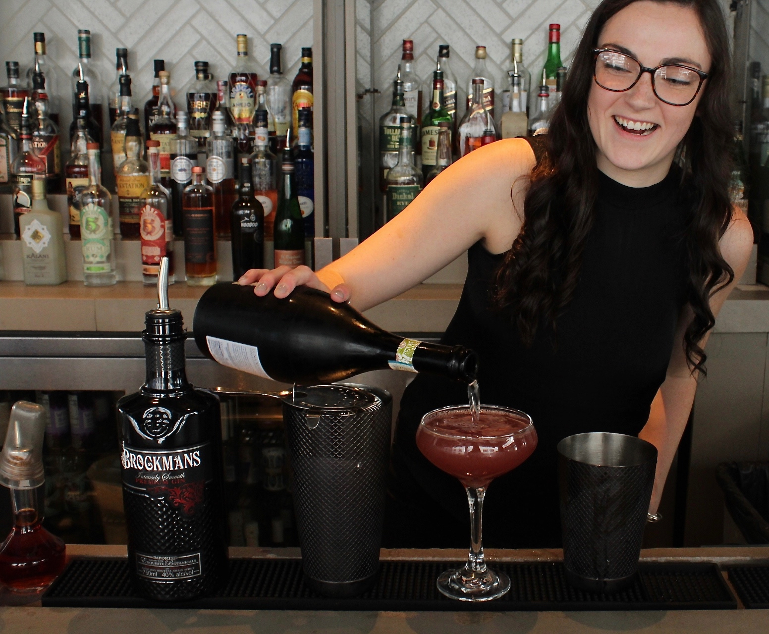 "Baileigh Wilson makes her Brockmans cocktail, ""You Had Me at Merlet"", at The High Note in Atlanta, Georgia"